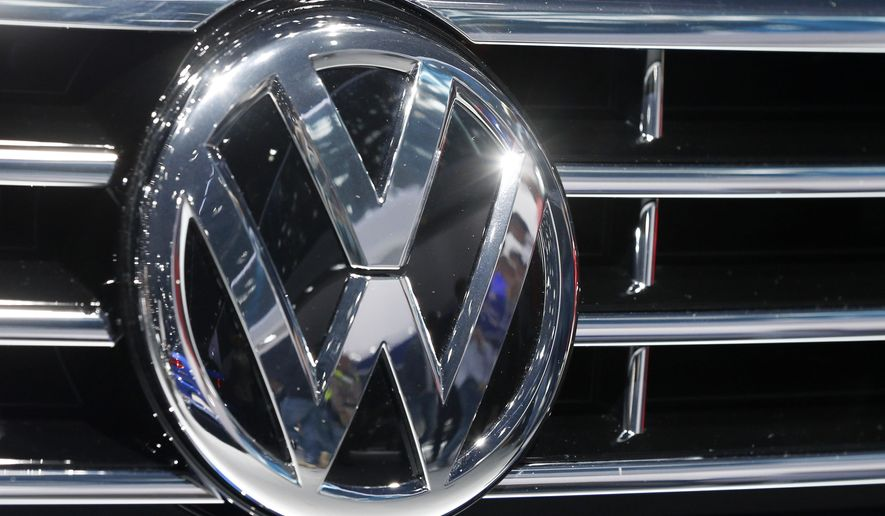 FILE - In this Sept. 22, 2015, file photo, the logo of Volkswagen at a car is photographed during the Car Show in Frankfurt, Germany. Shares in automaker Volkswagen are sliding after U.S. environmental officials said the company equipped more models than previously thought with software that let the cars cheat on diesel emissions tests. The company's ordinary shares fell 3.37 percent in midday trading Tuesday Nov.3, 2015.   (AP Photo/Michael Probst, File)