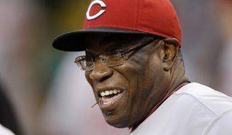 FILE - This Sept. 20, 2013,  file photo, shows then-Cincinnati Reds manager Dusty Baker (12) in the dugout before a baseball game against the Pittsburgh Pirates in Pittsburgh. The Washington Nationals say they have hired Dusty Baker as their manager. The team announced the move on Tuesday, Nov. 3, 2015.  (AP Photo/Gene J. Puskar, File)