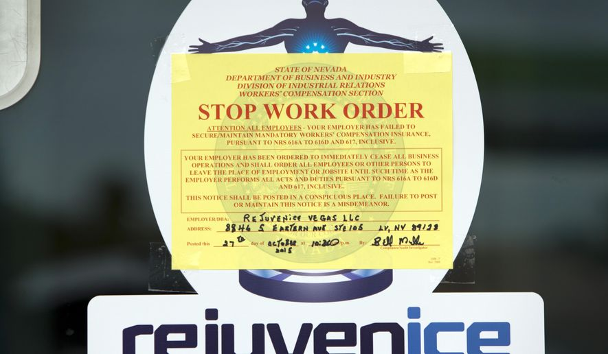 FILE - This Oct. 27, 2015 file photo shows a Stop Work Order on the front door of the Rejuvenice spa in Las Vegas. Nevada is looking into whether cryotherapy is safe for the general public after the death of a Las Vegas spa worker found inside a phone booth-sized chamber chilled with liquid nitrogen at Rejuvenice, regulators said Monday, Nov. 2, 2015. The state said it was shifting its investigation beyond workplace safety and the equipment used in the treatments to the health concerns surrounding the technology itself.(Steve Marcus/Las Vegas Sun via AP, File) MANDATORY CREDIT