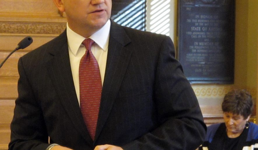 Scott Schultz, executive director of the Kansas Sentencing Commission, speaks to a joint legislative committee, Tuesday, Nov. 3, 2015, at the Statehouse in Topeka, Kan. Schultz says he's worried about looming budget problems pressuring the state into cutting funding to treat drug offenders and keep them out of prison. (AP Photo/John Hanna)