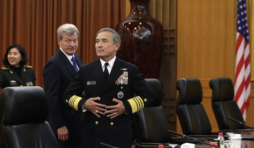 Adm. Harry B. Harris, Jr., U.S. Navy Commander, U.S. Pacific Command, center, and U.S. Ambassador to China Max Baucus, second left, arrive at the Bayi Building to meet with Chinese General Fang Fenghui, PLA Chief of General Staff, and Admiral Sun Jianguo, deputy chief of general staff of the PLA, in Beijing, China, Tuesday, Nov. 3, 2015. The U.S. Navy's challenge last week to China's sovereignty claims in the South China Sea was not designed as a military threat, the head of U.S. Pacific military forces said Tuesday in a mostly upbeat speech about prospects for preventing U.S.-China disputes from escalating to conflict. (AP Photo/Andy Wong, Pool)