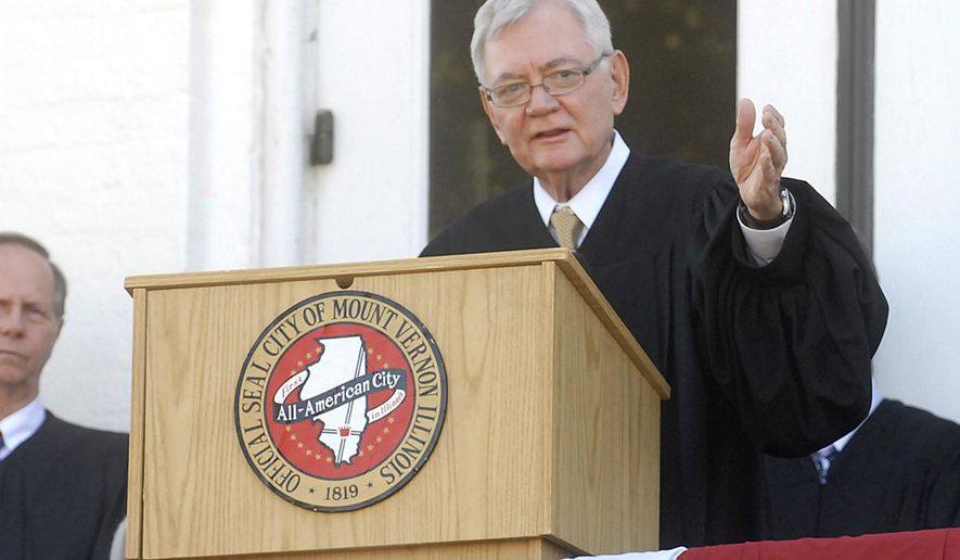FILE - In this Sept. 18, 2008 file photo, Illinois Supreme Court Chief Justice Thomas R. Fitzgerald speaks of Abraham Lincoln during a dedication of the 16th U.S. President's statue at the Fifth District Appelate Court in Mount Vernon, Ill. The former Chief Justice who stepped down in 2010 died Sunday Nov. 1, 2015, at his home. He was 74. (Steve Jahnke/The Southern, via AP, File)