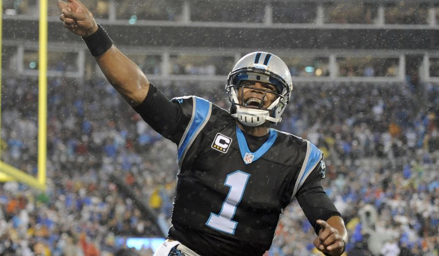 Carolina Panthers' Cam Newton (1) celebrates a Panthers touchdown against the Indianapolis Colts in the first half of an NFL football game in Charlotte, N.C., Monday, Nov. 2, 2015. (AP Photo/Mike McCarn)