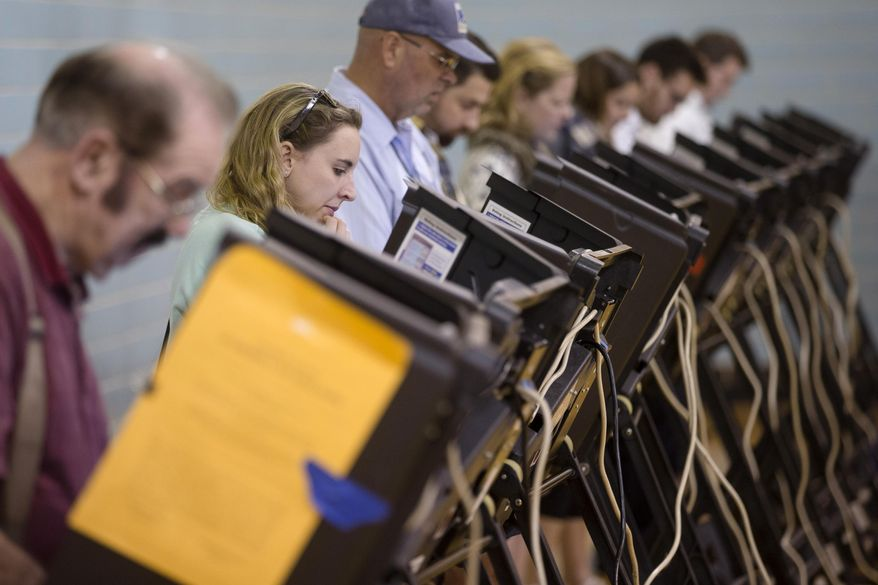 Computer security experts said bar codes on ballots and smartphones in voting locations could give hackers a chance to rewrite results in ways that couldn't be traceable. (Associated Press/File)