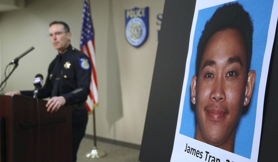 Sacramento Police Chief Sam Somers Jr., left, announces the arrest of  James Tran, who is charged with the attempted homicide of Airman 1st Class Spencer Stone during an altercation in October, in Sacramento, Calif., Wednesday, Nob. 4, 2015. Stone was one of three Americans who helped thwart a European terrorist attack. (AP Photo/Rich Pedroncelli)