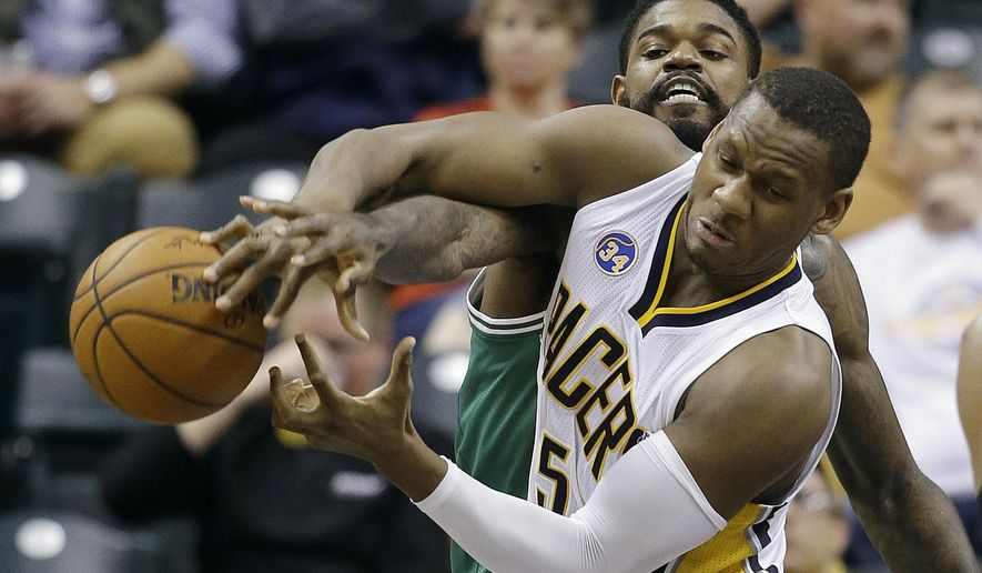 Indiana Pacers' Lavoy Allen (5) and Boston Celtics' Amir Johnson (90) battle for a loose ball during the second half of an NBA basketball game Wednesday, Nov. 4, 2015, in Indianapolis. The Pacers won the game 100-98. (AP Photo/Darron Cummings)