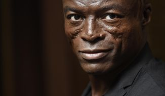 """In this Monday, Oct. 5, 2015 photo, singer/songwriter Seal poses for a portrait at Warner Bros. Records in Burbank, Calif. """"Seal 7"""" is the artist's first new music in five years: an album about love, heartbreak and healing. (Photo by Chris Pizzello/Invision/AP)"""