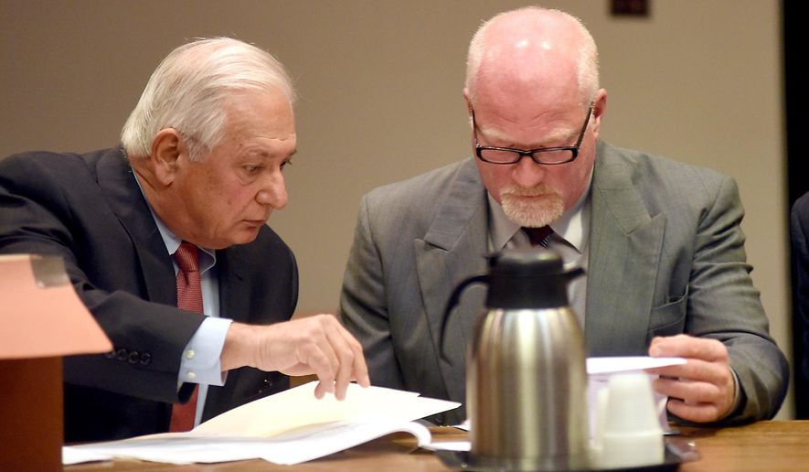 Suspended correction officer Gene Palmer, right, accused of inadvertently helping two killers escape from Clinton Correctional Facility in Dannemora, N.Y., with his lawyer William Dreyer, waived his right to have his case heard by a grand jury and pleaded not guilty to charges Wednesday Nov. 4, 2015 in Clinton County Court in Plattsburgh. Palmer now faces a felony charge in connection with hamburger containing hacksaw blades that he allegedly delivered to an inmate that escaped from Clinton Correctional a few days later. (Rob Fountain/Press-Republican via AP)