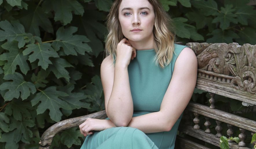 """In this Thursday, Oct. 8, 2015 photo, actress Saoirse Ronan poses for a portrait in promotion of her new film """"Brooklyn,"""" in New York. The movie opens in U.S. theaters on Nov. 4. (Photo by Amy Sussman/Invision/AP)"""