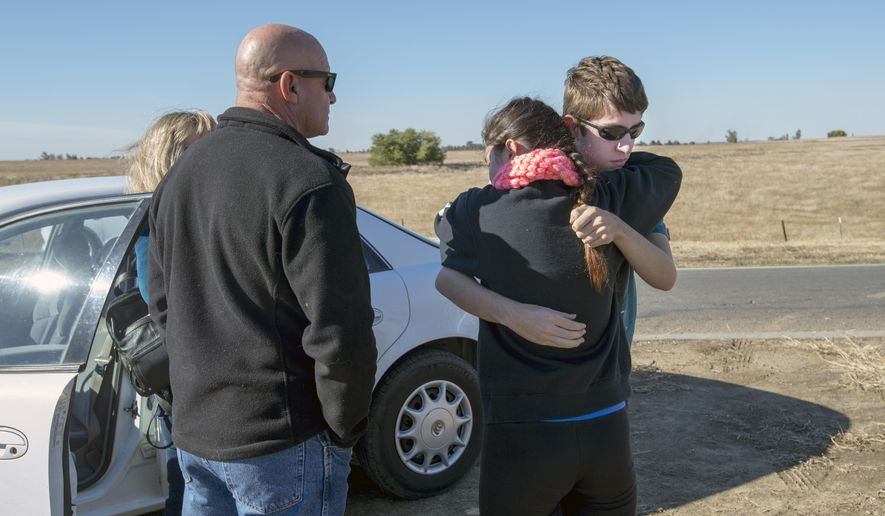 University of California, Merced student Justin Dick, right, hugs his sister Kristen as his parents Beth and Keith look on following a stabbing in Merced, Calif., Wednesday, Nov. 4, 2015. An assailant stabbed five people at the rural university campus in central California before police shot and killed him, authorities said Wednesday. Justin was one of 15 students in the core class where the incident took place Wednesday morning. (Paul Kitagaki Jr.(Paul Kitagaki Jr./The Sacramento Bee via AP)  MAGS OUT; LOCAL TELEVISION OUT (KCRA3, KXTV10, KOVR13, KUVS19, KMAZ31, KTXL40); MANDATORY CREDIT  (REV-SHARE) (ONLN OUT; IONLN OUT - MBI)