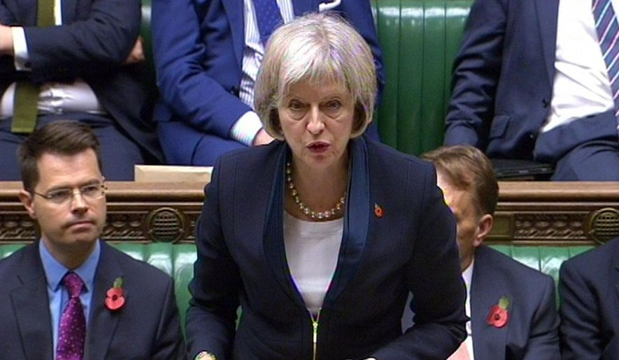 """In this video grab, Home Secretary Theresa May speaks in the House of Commons, in London, Wednesday, Nov. 4, 2015. British police and spies will get new powers to comb through citizens' online activity under a new law regulating cyber-snooping. The Investigatory Powers Bill, being published Wednesday, is designed to regulate authorities' access to Internet activity. It replaces a patchwork of laws, some dating from the Web's infancy. Home Secretary Theresa May has insisted that the government """"will not be giving powers to go through people's browsing history,"""" and says the law will contain safeguards against abuse. (PA via AP) UNITED KINGDOM OUT"""