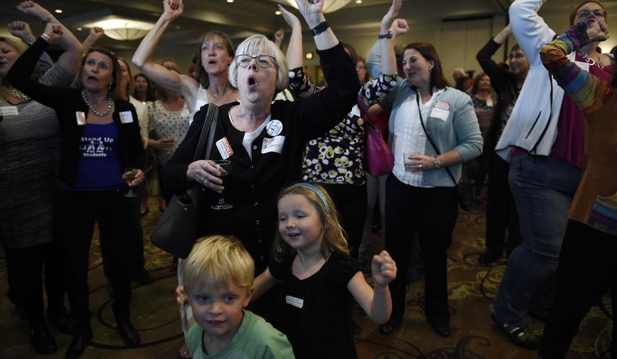 Supporters for the Jefferson County recall vote celebrate at the Sheraton Denver West hotel in Lakewood, Colo., Tuesday, Nov. 3, 2015. Suburban Denver voters on Tuesday ousted three conservative school board members who changed the way teachers are paid and briefly considered reviewing a U.S. history curriculum to promote patriotism. (Helen H. Richardson/The Denver Post via AP) MAGS OUT; TV OUT; INTERNET OUT; NO SALES; NEW YORK POST OUT; NEW YORK DAILY NEWS OUT; MANDATORY CREDIT