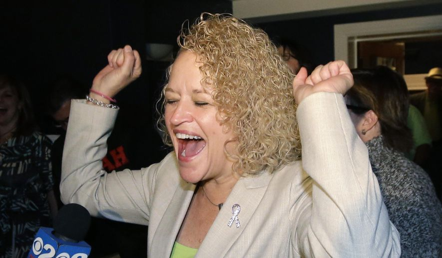 Former state lawmaker Jackie Biskupski reacts as results come in at her election night party for Salt Lake City Mayor, Tuesday, Nov. 3, 2015, in Salt Lake City. (AP Photo/Rick Bowmer)