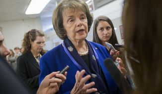 "In this June 2, 2015 file photo, Sen. Dianne Feinstein, D-Calif. speaks with reporters on Capitol Hill in Washington. It was another round of Cruz vs. Feinstein. Republican presidential candidate Ted Cruz and five-term Democratic Sen. Dianne Feinstein engaged in a heated exchange on the Senate floor on Wednesday over ""sanctuary cities"" that shield residents from federal immigration authorities and over human rights in China. (AP Photo/Pablo Martinez Monsivais, File)"