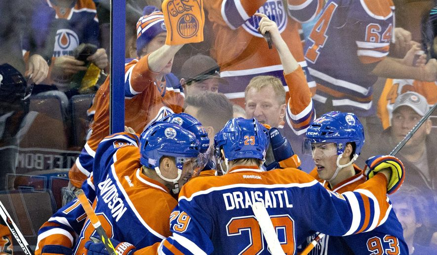 Edmonton Oilers celebrate a goal against the Philadelphia Flyers during the third period of an NHL hockey game Tuesday, Nov. 3, 2015, in Edmonton, Alberta. (Jason Franson/The Canadian Press via AP)