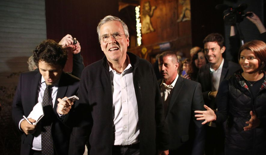 Republican presidential candidate, former Florida Gov. Jeb Bush, center left, walks with members of the media and supporters as he departs a campaign event held in a barn belonging to former .S. Sen. Scott Brown, R-Mass., Tuesday, Nov. 3, 2015, in Rye, N.H. (AP Photo/Steven Senne)