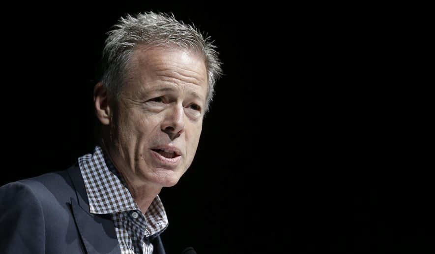 """FILE - In this June 18, 2014, file photo, Jeffrey Bewkes, Chairman and CEO of Time Warner, attends the Cannes Lions 2014, 61st International Advertising Festival in Cannes, southern France. Fans of superhero shows based in the DC Comics universe like """"The Flash,"""" ''Arrow"""" and """"Gotham"""" might have to wait a lot longer for past seasons' episodes to come to Netflix and Hulu. Bewkes, the chief executive of DC-owner Time Warner Inc., told analysts on a conference call Wednesday, Nov. 4, 2015, that the company is reconsidering whether to license series just a season old to such services, known as subscription video-on-demand services.   (AP Photo/Lionel Cironneau, File)"""