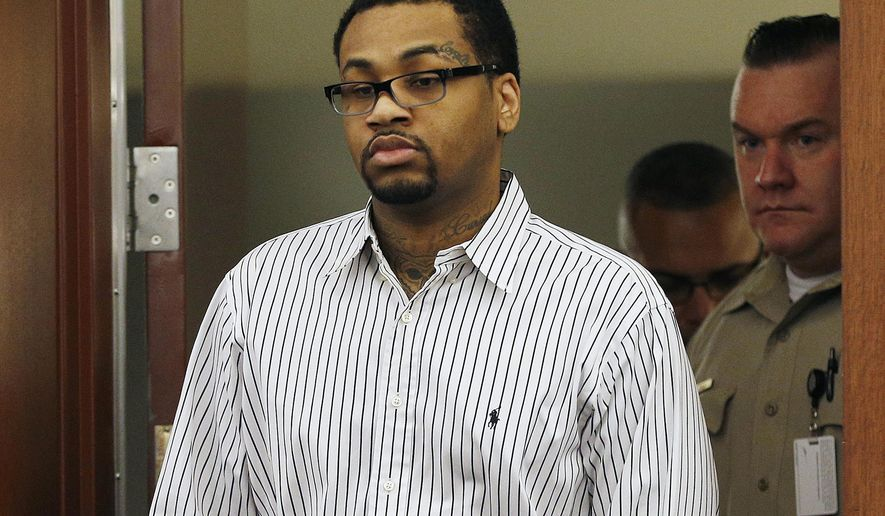 FILE - In this Monday, Oct. 12, 2015 file photo, Ammar Asim Faruq Harris walks into court in Las Vegas.  A jury decided Wednesday, Nov. 4, 2015, that the 29-year-old self-styled pimp should be sentenced to death for killing three people by opening fire into a moving vehicle after a dispute at a hip-hop event at a posh Las Vegas Strip resort. The jury deliberated two hours after a two-day penalty hearing that Harris chose not to attend. The same jury took less than 20 minutes Oct. 26 to find Harris guilty of first-degree murder, attempted murder and weapon charges in the February 2013 vehicle-to-vehicle shooting that sparked a fireball crash.  (AP Photo/John Locher, File)