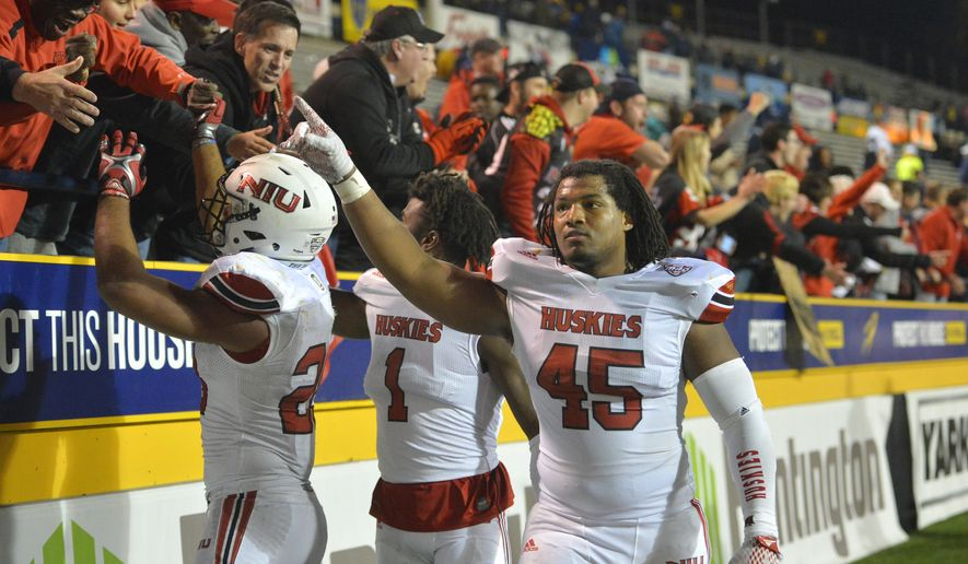 Northern Illinois linebacker Boomer Mays (45) points to fans after the team's 32-27 win over Toledo in an NCAA college football game Tuesday, Nov. 3, 2015, in Toledo, Ohio. (AP Photo/David Richard)
