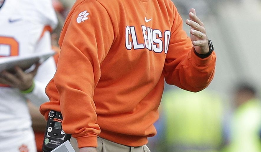 Clemson Dabo Swinney directs his team during the first half of an NCAA college football game against North Carolina State in Raleigh, N.C., Saturday, Oct. 31, 2015. Clemson won 56-41. (AP Photo/Gerry Broome)