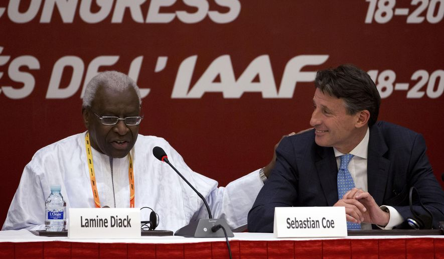 FILE - In this Aug.19, 2015 file photo, International Association of Athletics Federations outgoing president Lamine Diack, left, speaks next to newly elected president Sebastian Coe during a press briefing at the IAAF Congress at the National Convention Center in Beijing. The French office that handles financial prosecutions says Wednesday Nov.4, 2015  Diack has been placed under investigation on corruption and money-laundering charges, suspected of taking money from Russia to hide doping positives.(AP Photo/Andy Wong, File)