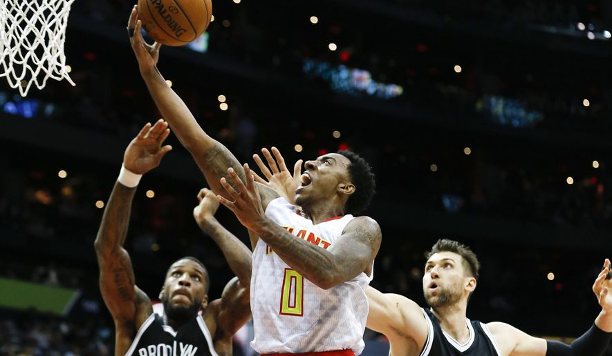 Atlanta Hawks guard Jeff Teague (0) drives to the basket as Brooklyn Nets' Thomas Robinson (41) and Andrea Bargnani (9) defend during the first half of an NBA basketball game Wednesday, Nov. 4, 2015, in Atlanta. (AP Photo/John Bazemore)