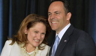 Kentucky Republican Gov.-elect Matt Bevin, right, and his wife, Glenna, react to the cheers of supporters during his introduction at the Republican Party victory celebration, Tuesday, Nov. 3, 2015, in Louisville, Ky. Bevin has defeated Democrat Jack Conway to become only the second Republican governor in the state in four decades. (AP Photo/Timothy D. Easley)
