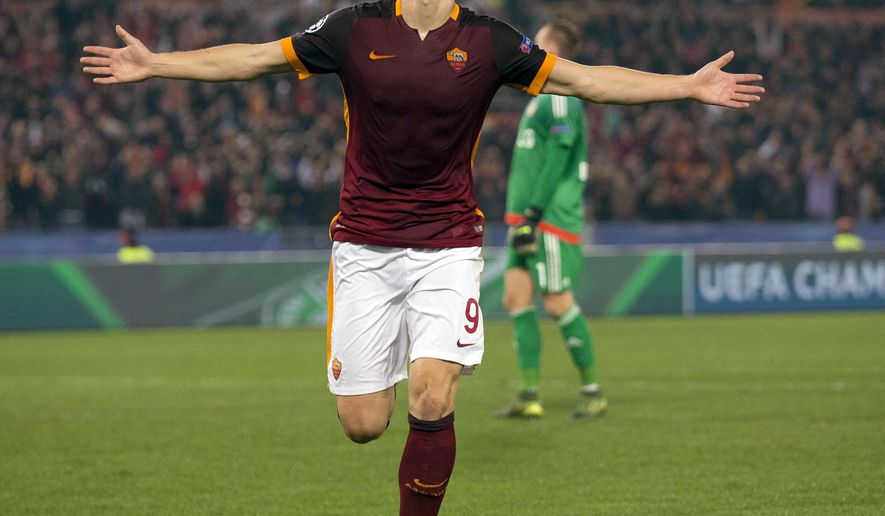 Roma's Edin Dzeko celebrates after scoring during the Champions League group E soccer match between Roma and Bayer Leverkusen at the Olympic stadium, in Rome, Italy, Wednesday, Nov. 4, 2015. (AP Photo/Andrew Medichini)