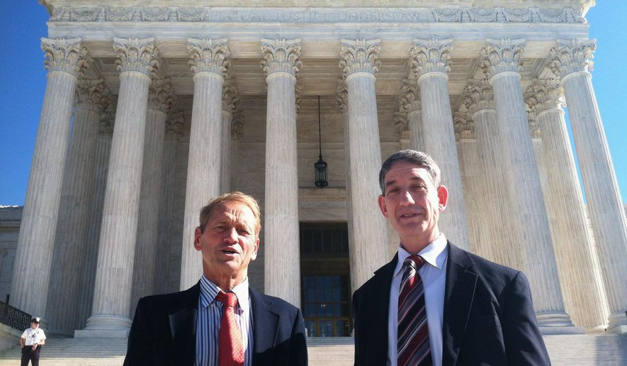 Maryland residents Stephen Shapiro, right, and John Benisek stand in front of the Supreme Court in Washington, Wednesday, Nov. 4, 2015, after a hearing in their case involving redistricting heard by the high court. Shapiro and Benisek are two of three Maryland residents who initially sued claiming the state's Congressional districts, as they were redrawn in 2011, violated their First Amendment and other rights.
