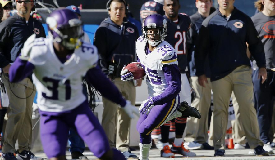 Minnesota Vikings's Marcus Sherels (35) runs to the end zone for a touchdown on a punt return during the first half of an NFL football game against the Chicago Bears, Sunday, Nov. 1, 2015, in Chicago. (AP Photo/Charles Rex Arbogast)