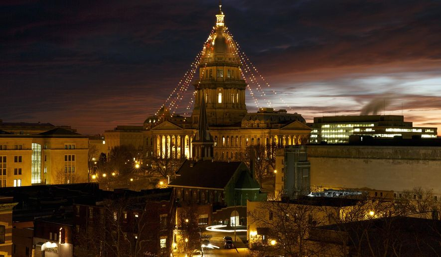 This Dec. 23, 2014 photo shows Christmas lights on the Illinois state Capitol dome in Springfield. The lack of a state budget means there won't be Christmas lights on the dome this year. Secretary of State Jesse White's office said Tuesday, Nov. 3, 2015, that it will skip the annual tradition because the lights are nonessential. (Rich Saal/The State Journal-Register via AP) MANDATORY CREDIT, NO SALES