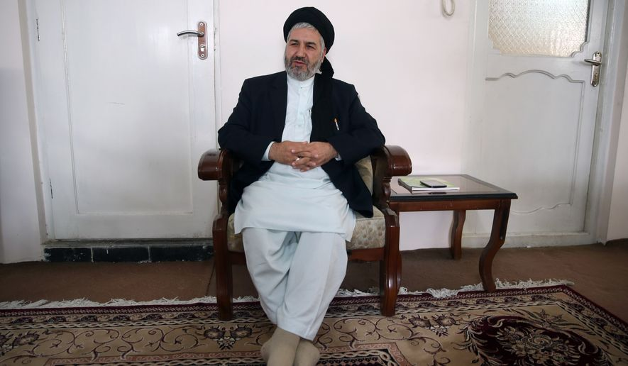 Afghanistan's Minister of Refugees and Repatriation Hossain Alemi Balkhi talks during an interview with The Associated Press at his home in Kabul, Afghanistan, in this Thursday, Oct. 29, 2015, file photo. An estimated 120,000 Afghans have left for Europe so far this year, according to Balkhi, He expects that number to reach 160,000 by the end of the year, four times the number who departed in 2013. (AP Photos/Massoud Hossaini)