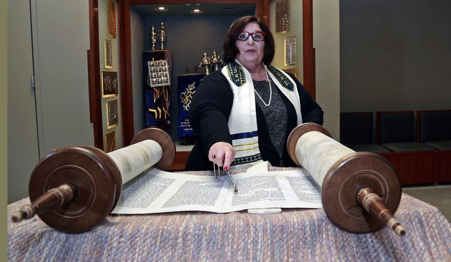 In this March 12, 2015 photo, Rabbi Denise Eger poses at Congregation Kol Ami, a Reform synagogue with gay and lesbian outreach programs, in West Hollywood, Calif. As a rabbinic student in 1980s New York City, Eger quietly started a group for fellow gay and lesbian students. The Reform Jewish movement has traveled a long road toward recognizing and embracing same-sex relationships. That journey has led this week to Philadelphia, where Eger will be installed Monday, March 16, 2015 as the first openly gay president of the Central Conference of American Rabbis, the rabbinical arm of Reform Judaism. (AP Photo/Nick Ut)