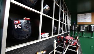 The batting helmet of Washington Nationals' Bryce Harper (34) is seen before a baseball game against the New York Mets at Nationals Park, Wednesday, Sept. 9, 2015, in Washington.  (AP Photo/Alex Brandon)
