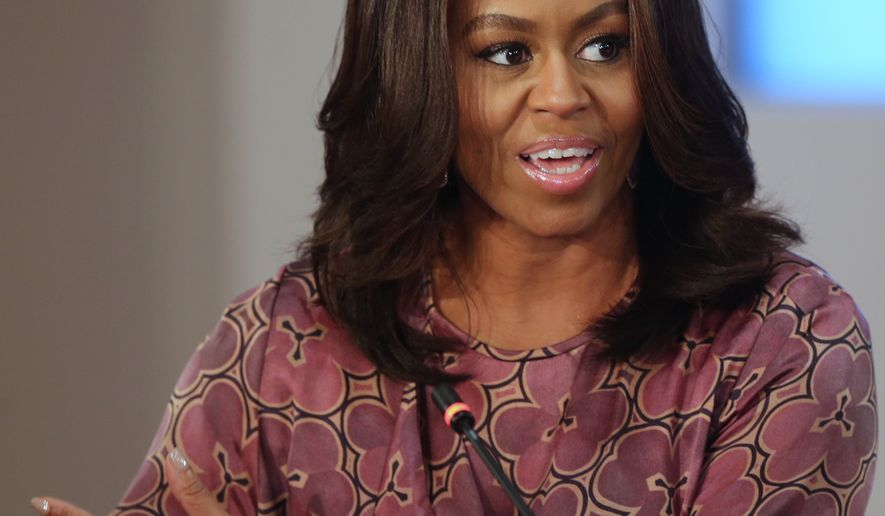 The U.S. first lady Michelle Obama participates in a round table discussion at the 2015 World Innovation Summit for Education held at the convention center in Doha, Qatar, Wednesday, Nov. 4, 2015. U.S. first lady Michelle Obama on Wednesday called on the world to fund and promote societal change to support girls' education. (AP Photo/Osama Faisal)