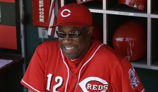 Cincinnati Reds manager Dusty Baker sits in the dugout prior to a baseball game against the Milwaukee Brewers, Sunday, Aug. 25, 2013, in Cincinnati. (AP Photo/Al Behrman)