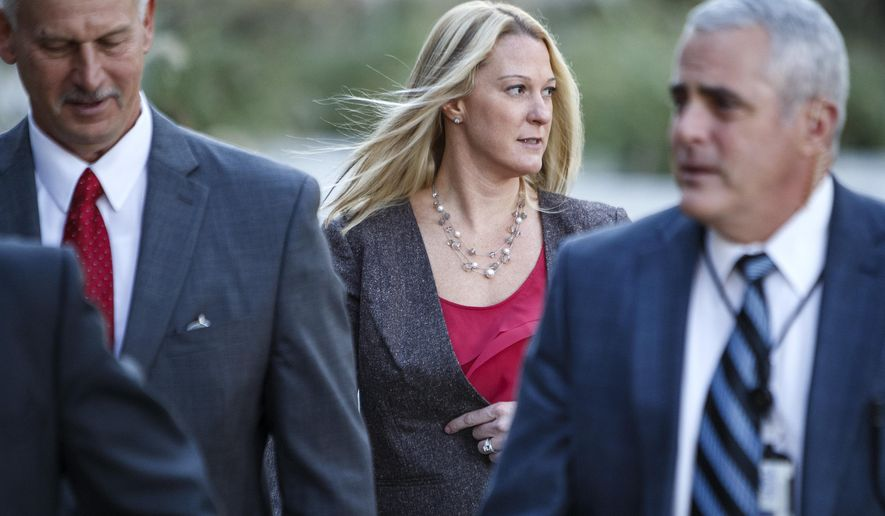 Hunnelstown police Officer Lisa Mearkle arrives for her murder trial at the Dauphin County Courthouse in Harrisburg, Pa. on Wednesday, Nov. 4, 2015. Mearkle is charged with third-degree murder for shooting David Kassick after he fled from a Feb. 2 traffic stop in Hummelstown, a Harrisburg suburb. The shooting was captured by a camera attached to her stun gun. (Dan Gleiter/PennLive.com via AP) MANDATORY CREDIT