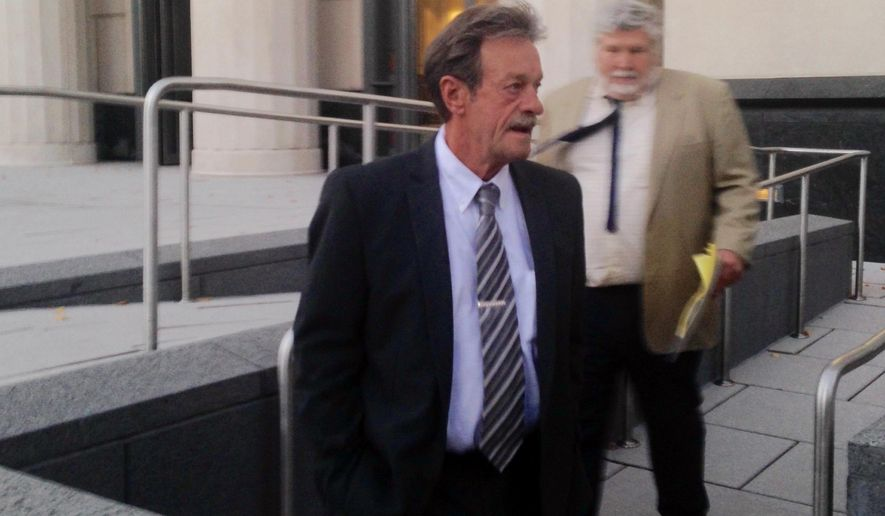 Witness William Ross, center, leaves U.S. District Court with his attorney, Wednesday, Nov. 4, 2015 in Charleston, W.Va.,  after testifying in the trial of former Massey Energy CEO Don Blankenship. Ross is one of the government's top witnesses and is a former Massey Energy safety official. Blankenship is charged with conspiring to break safety laws at the Upper Big Branch mine and lying to financial regulators about safety. The mine exploded in April 2010, killing 29 men.  (AP Photo/John Raby)