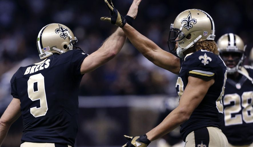 New Orleans Saints quarterback Drew Brees (9) celebrates with wide receiver Willie Snead (83) after Snead's touchdown reception in the first half of an NFL football game against the New York Giants in New Orleans, Sunday, Nov. 1, 2015. (AP Photo/Jonathan Bachman)