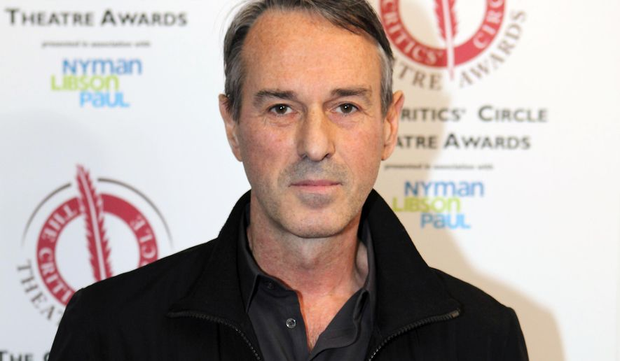 """FILE - In this Jan. 27, 2015 file photo, director Ivo Van Hove poses for photographers after winning the best director award for the play """"A View From the Bridge""""  at the Critics' Circle Theatre Awards in central London. Van Hove has two Broadway revivals of Arthur Miller plays _ """"A View From the Bridge"""" and """"The Crucible"""" _ and a new show co-written by David Bowie called """"Lazarus"""" downtown.  (Photo by Grant Pollard/Invision/AP), File"""