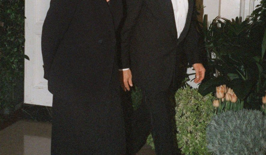 "FILE - In this Feb. 5, 1998 file photo, Harrison Ford and his wife Melissa Mathison arrive at the White House for an official dinner for the British Prime Minister hosted by President Clinton in Washington. Mathison, the screenwriter who crafted the enchanting worlds of iconic family films including ""E.T. the Extra Terrestrial,"" has died. She passed away Wednesday, Nov. 4, 2015, at age 65 after a bout with neuroendocrine cancer, her sister, Melinda Mathison Johnson, confirmed.  Mathison was married to Harrison Ford for 21 years and divorced in 2004. (AP Photo/Neshan H. Naltchayan, File)"