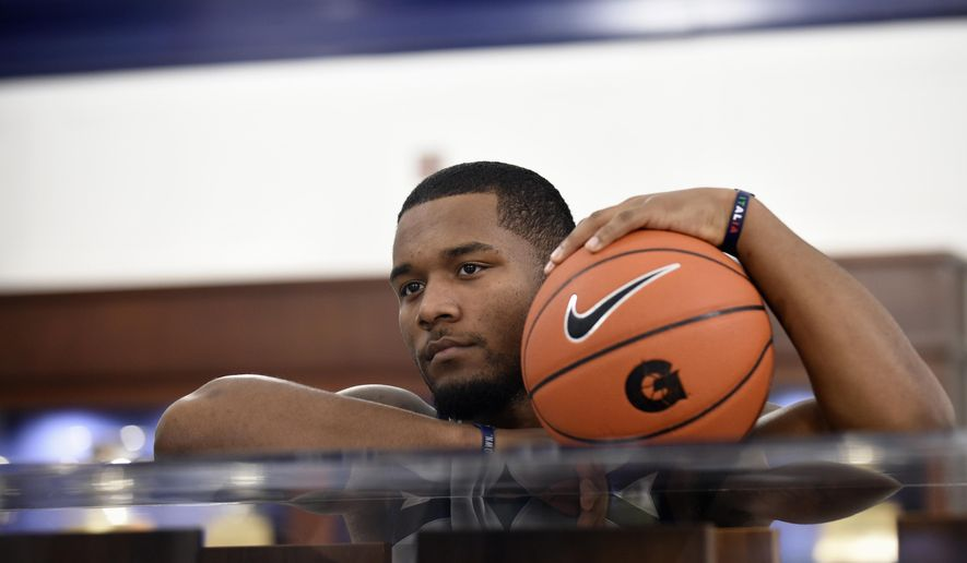 In this photo taken Oct. 27, 2015, Georgetown University men's basketball player D'Vauntes Smith-Rivera poses for a photo at McDonough Arena in Washington. Once again, Georgetown's season ended early, during the NCAA Tournament's opening week and, once again, against a lower-seeded opponent.  (AP Photo/Susan Walsh)