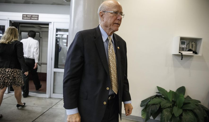 FILE - In this Dec. 9, 2014, file photo, Sen. Pat Roberts, R-Kansas arrives on Capitol Hill in Washington. Roberts on Nov. 4, 2015, placed a hold on President Barack Obama's nominee for the secretary of the Army to prevent the White House from taking executive action to close Guantanamo Bay and transfer detainees to the United States. (AP Photo/J. Scott Applewhite, File)