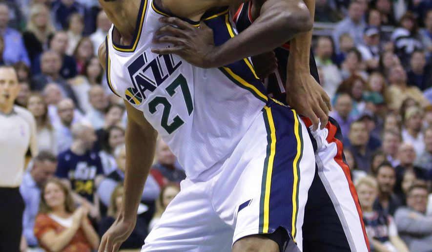 Utah Jazz center Rudy Gobert (27) and Portland Trail Blazers forward Noah Vonleh, rear, battle for position in the second quarter during an NBA basketball game Wednesday, Nov. 4, 2015, in Salt Lake City. (AP Photo/Rick Bowmer)