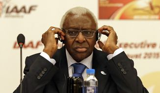 FILE - In this Aug.21, 2015 file photo, then IAAF president Lamine Diack adjusts his headphones during a joint IOC and IAAF press conference on the side of the World Athletic Championships in Beijing. The French office that handles financial prosecutions says Wednesday Nov.4, 2015 Diack has been placed under investigation on corruption and money-laundering charges, suspected of taking money from Russia to hide doping positives. (AP Photo/Kin Cheung, File)