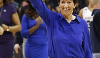 FILE - In this March 27, 2015, file photo, Notre Dame head coach Muffet McGraw leaves the court after her team beat Stanford 81-60 at a women's college basketball regional semifinal game in the NCAA Tournament, in Oklahoma City. (AP Photo/Sue Ogrocki, File)