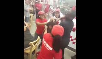 The Five Guys burger chain said it is investigating after video surfaced showing several employees attacking a female patron inside a Miami Beach franchise. (YouTube/@BurrTv A1LenzProductions)