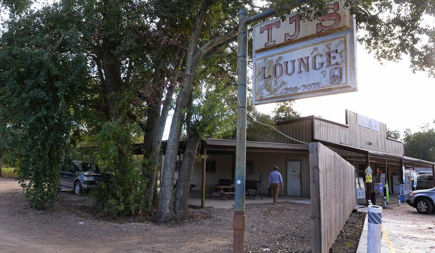 This Wednesday, Nov. 4, 2015 photo shows TJ'S Lounge in Marksville, La. A 6-year-old boy was killed and his father critically wounded after marshals for a central-Louisiana city fired at their vehicle as the father was trying to flee, officials said. (Patrick Dennis/The Baton Rouge Advocate via AP) MAGS OUT; INTERNET OUT; NO SALES; TV OUT; NO FORNS; LOUISIANA BUSINESS INC. OUT (INCLUDING GREATER BATON ROUGE BUSINESS REPORT, 225, 10/12, INREGISTER, LBI CUSTOM); MANDATORY CREDIT