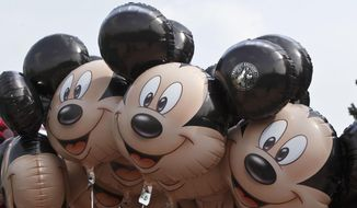 This May 12, 2015, file photo shows Mickey Mouse balloons at Disneyland Paris, in Chessy, France, east of Paris. (AP Photo/Michel Euler, File)