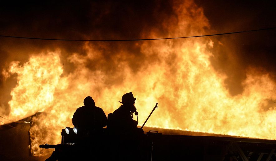 Fire crews battle a blaze at Acorn Design & Manufacturing in South Londonderry Township, Pa., on Thursday, Nov. 5, 2015. Firefighters from several counties were at the scene. (Jeremy Long/Lebanon Daily News via AP) THE PATRIOT-NEWS OUT; MANDATORY CREDIT